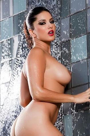 Babe Poses Naked On Waterfalls