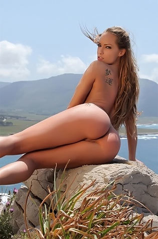 Brunette Babe Poses Naked On Rocky Hills