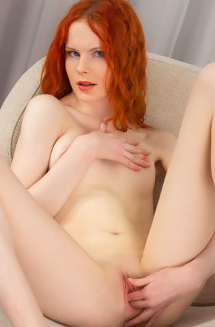 Redhead Babe Fingering On Couch