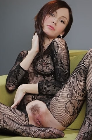 Babe On Fishnet Showing Her Pussy