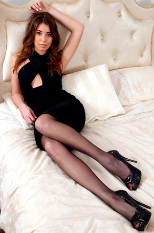Brunette Chastity In Black Lace Stockings